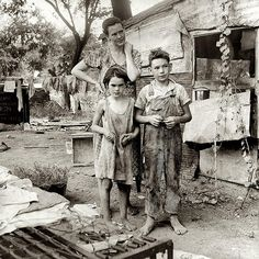 Depression Era - 1935 to 1939 by alanoftulsa, via Flickr.  This is what poverty used to look like