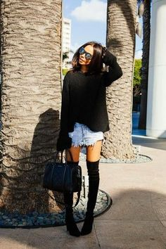 Women's Black Oversized Sweater, Light Blue Denim Shorts, Black Leather Duffle Bag, and Black Suede Over The Knee Boots
