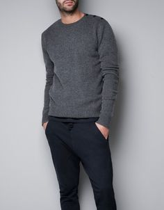 SWEATER WITH SHOULDER BUTTONS