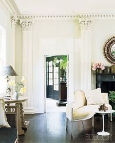 That moulding! Gorgeous Great room/living room & a peak to the entryway. #interior #design #inspiration
