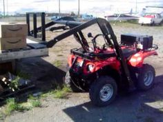 GroundHog loader with Forks attachment on ATV/Quad
