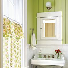 Decorate with Green | Bold colors give rooms instant personality. The bright shade of green in this bath is cheery and lively. | SouthernLiving.com