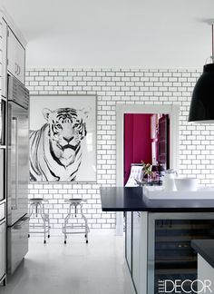 In Erika Beraman's Hamptons home, the kitchen's stools are by Design Within Reach, the ceiling fixture is from YLighting, the refrigerator and wine cooler are Sub-Zero, and the photograph is from Natural Curiosities. - ELLEDecor.com