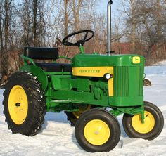 John Deere...so much more fun in the Spring!