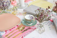 When searching for tea party ideas I stumbled across Lauren's fabulous blog, A fabulous fete, I found this lovely vintage tea party that was held for a very lucky 4 year old! I absolutely adore the spring color palette used...