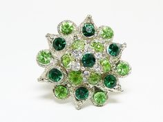 Fall Sale - Marked Down 20% ! #GiftIdeas FALL SALE - 20% off -  Green Rhinestone Ring - One Size Fits All - Domed #Vintage Jewellery offered by TheJewelSeeker  This domed ring has multi shades of green and clear rh... #vintage #jewelry #teamlove #etsyretwt #ecochic #thejewelseeker #leaves #leaf #flowers