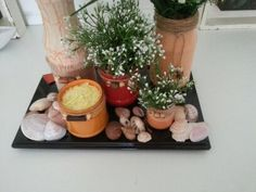 decoração de vidros , pote com vela e conchas