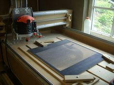 Tomi's halftone was created with 3,774 holes drilled at a rate of around one per second by a DIY CNC 2. [Via Ponoko]