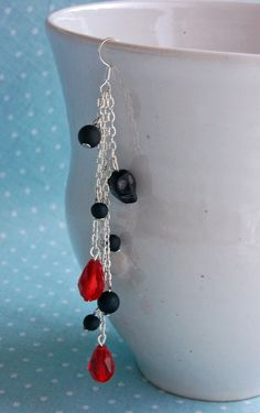 Black skull silver earring with red teardrop crystal beads and matte black glass beads by otterlydesign, $13.00