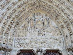 """The """"Judgement of the souls"""" above one door in  Notre Dame de Paris"""