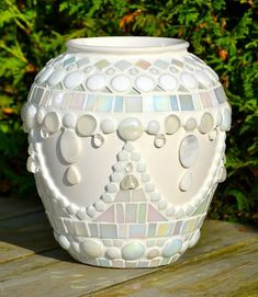 White flower vase, partially covered with white glass mosaic and small ceramic tiles. Includes iridescent tiles, glass drops, glitter tiles,