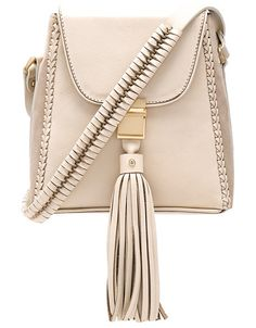 Milla Jet Set Mini Bag by Sancia. Leather exterior with poly fabric lining. Flap top with push buckle closure. Adjustable shoulder strap. Exterior zip ...