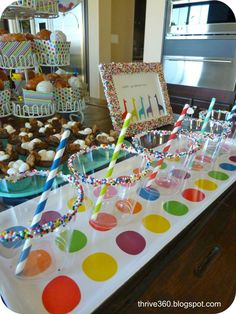 #Rainbow sprinkle covered cups at this #donut themed #party- yum!
