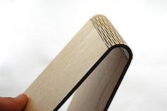 Birch plywood with a pattern cut into it that makes it flexible.