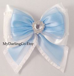 This Bow is Disney Inspired, Cinderella from the Movie Cinderella.    Blue and White Satin and Organza Ruffle Princess Bow with Beautiful Heart