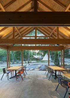japanese design studio mori no terrace has created a camping café called 'terrace of the forest' using locally sourced material in osaka, japan. Black House Exterior, Interior And Exterior, Gable House, Getaway Cabins, Terrace Design, Japanese Design, Campsite, Pergola, Outdoor Structures