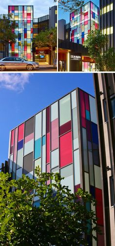 The front facade of this resort is covered in colored rectangular windows that add a pop of color to the street.
