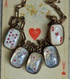 This 1920s vintage royal flush charm bracelet from BlueGrotto is available on Etsy.