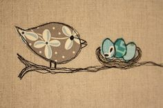 Use Linen for the cushion and machine stitch around fabric bird and eggs.