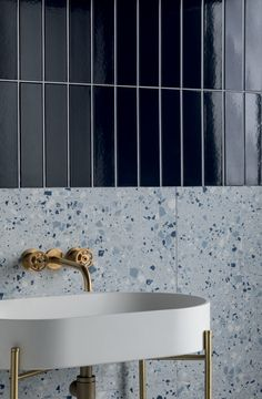 Our Norse Midnight Blue Gloss Ceramic Tile is a uniquely stunning metro tile. Shop this high gloss blue ceramic wall tile online or visit our UK showrooms. Mandarin Stone, Bathroom Interior, Bathroom Design Small, Toilet Tiles, Blue Tile Wall, Terrazzo Tile, Tile Trends, Tile Bathroom, Terrazzo