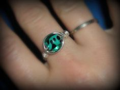 Fun to wear green/blue animal print glass ring. A must have for your jewelry collection! Anti-tarnish wire This listing is for a size 8 Let me know if you would like a different size.