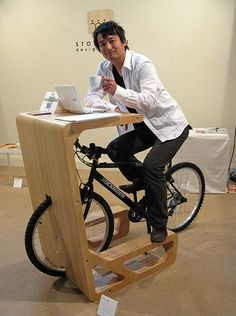 Bike desk, storage solution for small apartment spaces. It would be even better if you elevated the bike so you can ride and work.
