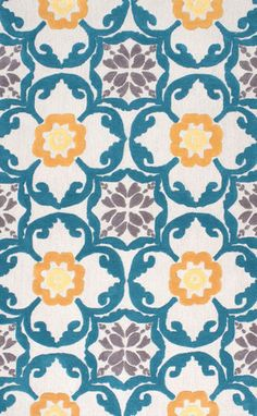 Hand-tufted area rug made of polyester featuring a pattern with modern colors perfect for an elegant room setting.