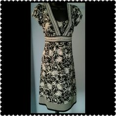 """Ann Taylor Dress Beautiful black and cream dress. Cap sleeves zip up the side. 39"""" long. Measures 17"""" across the chest. Ann Taylor Dresses Midi"""