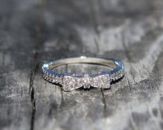 Available @ TrendTrunk.com Size 6 - MINI BOWTIE CZ RING WITH RHODIUM PLATING Jewellery. By Size 6 - MINI BOWTIE CZ RING WITH RHODIUM PLATING. Only $48.00! Plating, Wedding Rings, Engagement Rings, Mini, Jewellery, Enagement Rings, Jewels, Jewelry Shop, Commitment Rings