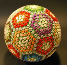 """These stunning embroidered balls called """"temari"""" were made by the prodigiously nimble fingers of a 92-year-old grandmother in Japan. Although she only learned this elaborate skill in her sixties, she has since created nearly 500 unique designs that have been photographed by her granddaughter NanaAkua. Impressive does not even begin to describe this feat of dexterity, imagination and keen eyesight. The difficult process of becoming a recognized temari craftsman in Japan is tedious and…"""