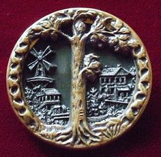 Antique button, scenic - with a tree in foreground, windmill & houses in the background. 19th. cent.