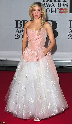 Having her princess moment: Ellie Golding makes an entrance in a pink and white ballgown as she arrives at the 2014 Brit Awards at London's ...