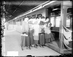 Five women getting on an open air L train at Jackson Park on November 1, 1915.