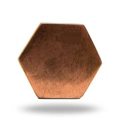 Update the look of your furniture and make it feel new again with a unique decorative knob from the Trinca-Ferro collection! This modern and contemporary knob is made from copper metal and is in the shape of a hexagon. The perfect way to bring some interest and some design to your living