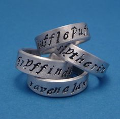 Harry Potter Inspired - Hogwarts Houses - A Set of Hand Stamped Aluminum Rings. $40.95, via Etsy.