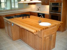 DeVos Custom Woodworking - Hard Maple Wood Countertop Photo Gallery  ****This shoes you an example of edge grain, with a built-in knife slot and Tung-Oil Finish in Hard Maple.