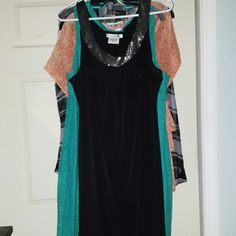 Little Black Dress with bead accents Midi length. Black jersey dress with delicate beading at the collar. Worn once. Great for work and then into an evening out with friends. Dresses Midi