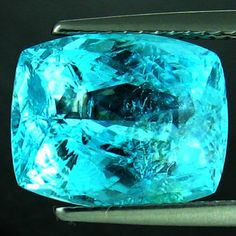 Paraiba Tourmaline - I have fallen in love with the color of this gem.  Rare & expensive...great. Of course, I would. Boo. :/