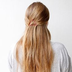 Turn standard bobby pins into chic -- and inexpensive -- hair accessories. Pull the top half of your hair back and secure with a horizontally placed bobby pin. Then add a pin on each side, forming a triangle. The end result looks graphic and modern while keeping your hair out of your face./