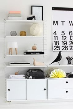 The best benefit of these supersized Helvetica calendars? You'll always know the date. Why are we all sticking to our itty-bitty calendars when we could have this hanging on our wall?  Read more at ELLEDecor.com: 13 Stunning IKEA Makeovers that Are Anything But Cookie-Cutter   - ELLEDecor.com