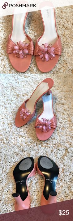 "Nine West pink heels Like new condition! Only worn once.  Nine West ""suma"" slide heel comes in a gorgeous shade of salmony pink. Floral enamel embellishment on top in shades of pink gives this shoe a perfect spring vibe! Heel height is low- only a couple inches. Virtually zero signs of wear. No rips, or damage to the leather uppers. No wear to toe box or sole. I placed anti-skid protectors. Smoke and pet free home. Will ship with a different shoe box than original. Make offer! Nine West…"