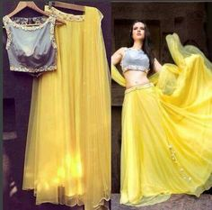 Crop top with a yellow skirt Choli Designs, Lehenga Designs, Blouse Designs, Ethnic Outfits, Indian Outfits, Fashion Outfits, Indian Attire, Indian Wear, Modern Saree