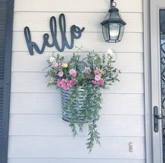 Welcoming front porch decor! Flowers and hello.