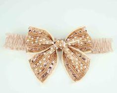 Gold-beaded-bridal-garter-bows-2012-wedding-trend.full