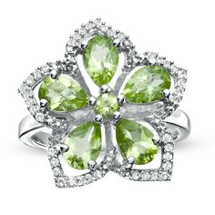Hmm, love the color! That is so pretty. Peridot and White Topaz Flower Ring in Sterling Silver