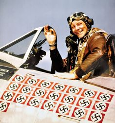 US fighter pilot Fred Christensen (1921-2006) in his P-47D Thunderbolt fighter which is decorated with swastikas to show the number of enemy planes the ace had shot down.Christensen, flying with 62nd Fighter Squadron of the 56th Fighter Group, 8th Air Force flew 107 combat missions and scored 21 aerial victories (including six German transport U-52s in one day).