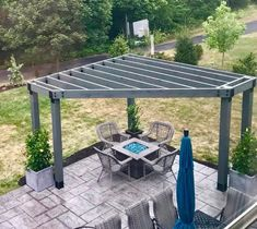 Love the view of this familys corner #pergola over their fire pit! Notice how the color of the glass rocks tie in with their umbrella! Beautiful OWTdoor living space! #ProjectPergola #CornerPergola #OWThardware OZCOBP.com ...s in using slats or lattice for a roof that will diffuse the sun's rays when they are at their peak. Two by two inch slats that are spaced a few inche...warp or split.The use of proper nails and fasteners is also essential for professional appearance and long-lasting perform Pergola D'angle, Corner Pergola, Wooden Pergola, Pergola Lighting, Metal Pergola, Fire Pit Pergola, Gazebo, Black Pergola, Patio Awnings
