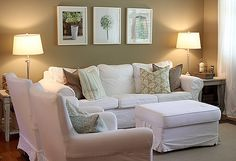 Tan walls + white couches, but I would want more color added in the pillows, pictures, etc. Still very pretty here, though - love the shabby tables!