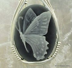 I've never seen this gray/black cameo combo before! Butterfly Cameo Pendant Design $49.97 #ibhandmade