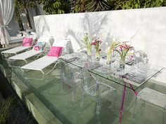 I love the way this table and chairs vanish. They add no visual weight to the lovely outdoor setting.